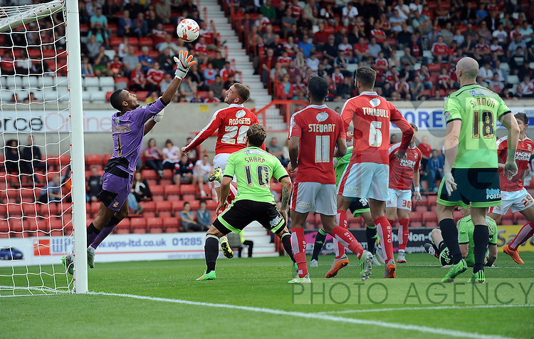 Neill Collins of Sheffield United scores the opening goal of the game past Swindon Town goalkeeper Lawrence Vigouroux<br /> - English League One - Swindon Town vs Sheffield Utd - County Ground Stadium - Swindon - England - 29th August 2015 <br /> --------------------