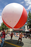 A ball is lifted into the air during the 21st  Annual Fremont Summer Solstice Parade in Seattle on June 21, 2009.  The parade was held Saturday, bringing out painted and naked bicyclists, bands, belly dancers and floats. (Jim Bryant Photo © 2009)