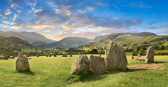 View of neolthic Castlerigg Stone Circle monaliths and the Lake District, England,  built circa 2500 BC.<br /> <br /> Castlerigg Stone Circle was built around 4500 years ago by prehistoric farming communities who settles in the fertile valleys of the Lake District.  Current thinking has linked Castlerigg with the Neolithic Langdale axe industry in the nearby Langdale fells: the circle may have been a meeting place where these axes were traded or exchanged. Ritually deposited stone axes have been found all over Britain, suggesting that their uses went far beyond their practical capabilities. Exchange or trading of stone axes may not have been possible without first taking part in a ritual or ceremony.