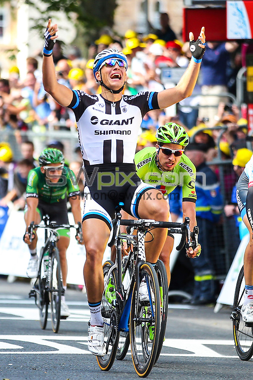 Picture by Alex Whitehead/SWpix.com - 05/07/2014 - Cycling - Tour de France 2014 Grand Depart - Stage 1, Leeds to Harrogate - Yorkshire, England - Team Giant-Shimano's Marcel Kittel celebrates winning Stage 1 in Harrogate.