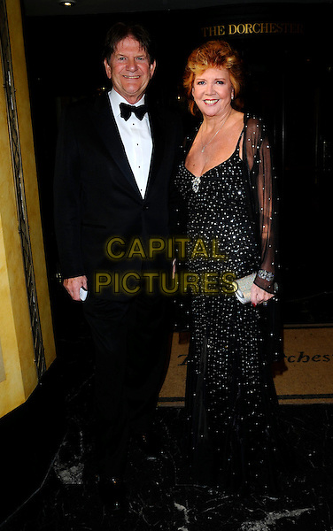 JOHN MADESJKI & CILLA BLACK .At the Bruce Forsythe Tribute Dinner,.The Dorchester Hotel, London,.England, UK, June 28th 2008..full length  tuxedo jacket suit black bow tie dress long silver sparkly sheer jacket sleeves cardigan.CAP/CAN.©Can Nguyen/Capital Pictures