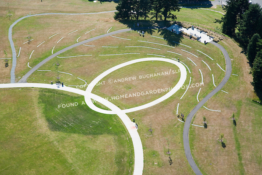 aerial photo of landscape art installation as part of the makeover of Seattle's Jefferson Park, former site of two urban reservoirs on Seattle's Beacon Hill; while the larger was buried underground and lidded, this smaller of the two is now drained, filled, and topped with playfields and these cement contour lines that show heights above sea level and represent the approximate shape of the former reservoir at various levels; Seattle, WA; July, 2011