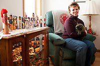 Cheryl Roucha sits amid her Punxsutawney Phil memorabila at home. Her husband Ron Ploucha, is one of Phil's two handlers.