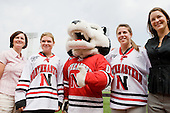 Linda Lundrigan (Northeastern - Interim Co-Head Coach), Annie Hogan (Northeastern - Co-Captain), Paws, Lindsay Berman (Northeastern - player), Lauren McAuliffe (Northeastern - Interim Co-Head Coach) - A press conference hosted by the Hockey East Association, the Boston Red Sox and Fenway Sports Group was held on Thursday, August 20, 2009, at Fenway Park in Boston, MA, to announce that there would be a Hockey East college hockey doubleheader on Friday, January 8, 2010, held on the ice that will be used for the January 1, 2010 NHL Winter Classic.  The afternoon (4:00 pm EST) match will be between the Northeastern University Huskies (home team) and University of New Hampshire Wildcats women's teams while the evening (7:30 pm EST) match will be between the Boston College Eagles (home team) and the Boston University Terriers men's teams.