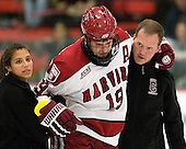?, Alex Killorn (Harvard - 19), Steve Chouinard (Colgate - Trainer) - The Harvard University Crimson defeated the visiting Colgate University Raiders 4-2 on Saturday, November 12, 2011, at Bright Hockey Center in Cambridge, Massachusetts.