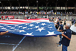 DEADWOOD, SD - AUGUST 8: Veterans and others gathered to hold the large flag during the opening ceremonies at the Iron Horse Rodeo held at the Days of 76 Rodeo Grounds Saturday. (Photo by Richard Carlson/dakotapress.org)