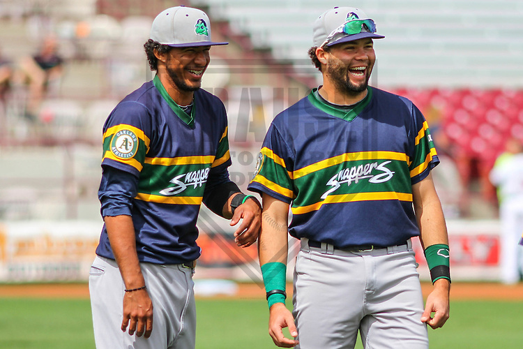 APPLETON - August 2014: Luis Baez (3) and Michael Soto (5) of the Beloit Snappers during a game against the Wisconsin Timber Rattlers on August 26th, 2014 at Fox Cities Stadium in Appleton, Wisconsin.  (Photo Credit: Brad Krause)