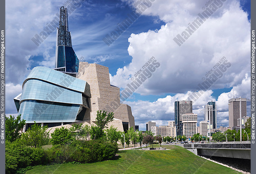 Canadian Museum for Human Rights and downtown skyline under beautiful cloudy sky on a summer day in Winnipeg, Manitoba, Canada 2017.