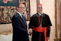 Cardinal Tarcisio Bertone Prince Albert of Monaco; poses with Prince Albert of Monaco during a private audience in the pontiff's library at the Vatican, Friday, Oct. 16, 2009.