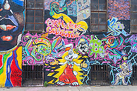 "Mural in Bushwick, Brooklyn in New York promotes the Bushwick Collective, on Saturday, June 4, 2016. Music and partying brought some but the real attraction was the new murals  by ""graffiti"" artists that decorate the walls of the buildings that the collective uses.  (© Richard B. Levine)"