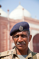 Agra, India.  Taj Mahal, Armed Security Guard.  Taj Mosque in Background.