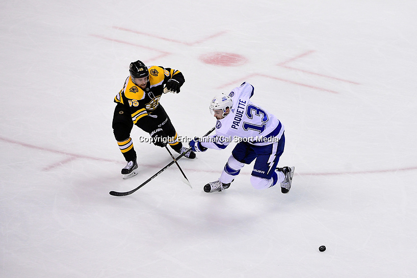 May 2, 2018: Boston Bruins defenseman Matt Grzelcyk (48) and Tampa Bay Lightning center Cedric Paquette (13) in game action during game three of the second round of the National Hockey League's Eastern Conference Stanley Cup playoffs between the Tampa Bay Lightning and the Boston Bruins held at TD Garden, in Boston, Mass. Tampa Bay defeats Boston 4-1. Eric Canha/CSM