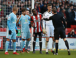 Referee talks to Clayton Donaldson of Sheffield Utd  during the Championship match at Bramall Lane Stadium, Sheffield. Picture date 26th December 2017. Picture credit should read: Simon Bellis/Sportimage