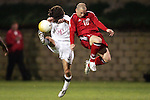 22 January 2006: US midfielder Ben Olsen (14) and Canada's Sandro Grande (10) battle for the ball in midfield. The United States Men's National Team tied Canada 0-0 at Torero Stadium in San Diego, California in an International Friendly soccer match.