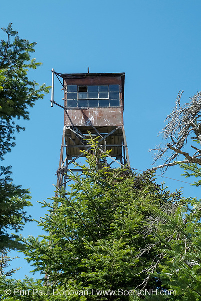 Old Fire Tower next to Smarts Mountain cabin. Located on the Appalachian Trail (Lambert Ridge Trail)  at 3220 feet on Smarts Mountain in New Hampshire USA..Notes: A 41 foot steel tower is located on Smarts Mountain near the cabin. The tower was built in 1915
