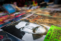 "Paperback books, depicting the drug lord Pablo Escobar on their covers, are seen arranged at the market stand on the street in Medellín, Colombia, 7 December 2017. Twenty five years after Pablo Escobar's death, the legacy of the Medellín Cartel leader is alive and flourishing. Although many Colombians who lived through the decades of drug wars, assassinations, kidnappings, reject Pablo Escobar's cult and his celebrity status, there is a significant number of Colombians who admire him, worshipping the questionable ""Robin Hood"" image he had. Moreover, in the recent years, the popular ""Narcos"" TV series has inspired thousands of tourists to visit Medellín, creating a booming business for many but causing a controversial rise of narco-tourism."