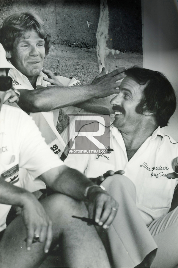 Atlas Van Lines driver Chip Hanauer and Miss Budweiser driver Jim Kropfeld share a light moment during the driver's meeting prior to the race at Evansville.