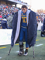 Annapolis, MD - December 28, 2017: Navy Midshipmen quarterback Malcolm Perry (10) in a walking boot during the  game between Virginia and Navy at  Navy-Marine Corps Memorial Stadium in Annapolis, MD.   (Photo by Elliott Brown/Media Images International)