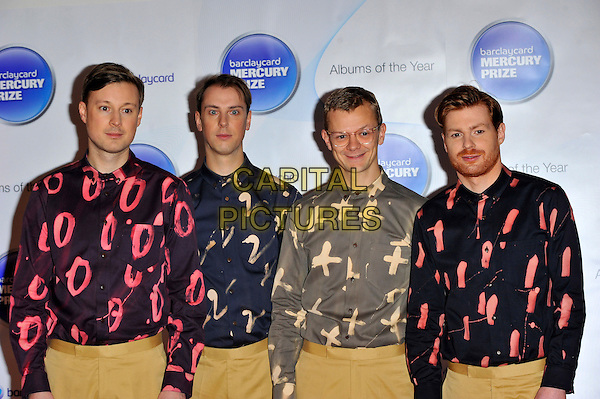 Django Django.Attending the Barclaycard Mercury Prize Album of the year Award, held at the Roundhouse, Camden, London, England, UK,.November 1st 2012..arrivals half length band group print shirt shirts matching pink red grey blue beige trousers .CAP/CJ.©Chris Joseph/Capital Pictures.