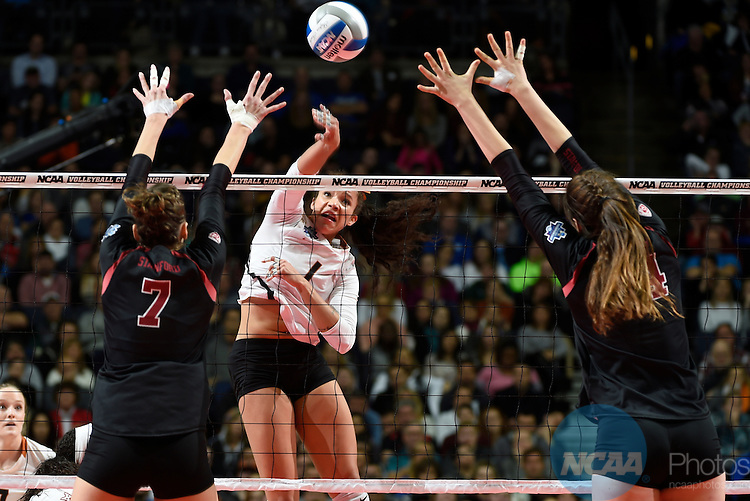 COLUMBUS, OH - DECEMBER 17:  MIcaya White (1) of the University of Texas tries to make a kill against Stanford University during the Division I Women's Volleyball Championship held at Nationwide Arena on December 17, 2016 in Columbus, Ohio.  Stanford defeated Texas 3-1 to win the national title. (Photo by Jamie Schwaberow/NCAA Photos via Getty Images)