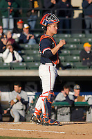 University of Virginia Cavaliers catcher Matt Thaiss (21) behind the plate during a game against the Kent State Golden Flashes at Ticketreturn.com Field at Pelicans Ballpark on February 19, 2016 in Myrtle Beach, South Carolina. Virginia defeated Kent State 8-6. (Robert Gurganus/Four Seam Images)