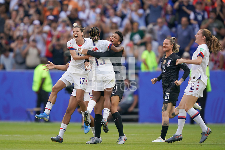 LYON, FRANCE - JULY 07: Tobin Heath #17, Crystal Dunn #19, Adrianna Franch #21 after the 2019 FIFA Women's World Cup France final match between the Netherlands and the United States at Stade de Lyon on July 07, 2019 in Lyon, France.