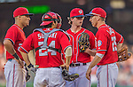 8 June 2013: Washington Nationals pitcher Erik Davis talks with teammates  on the mound during a game against the Minnesota Twins at Nationals Park in Washington, DC. The Twins edged out the Nationals 4-3 in 11 innings. Mandatory Credit: Ed Wolfstein Photo *** RAW (NEF) Image File Available ***