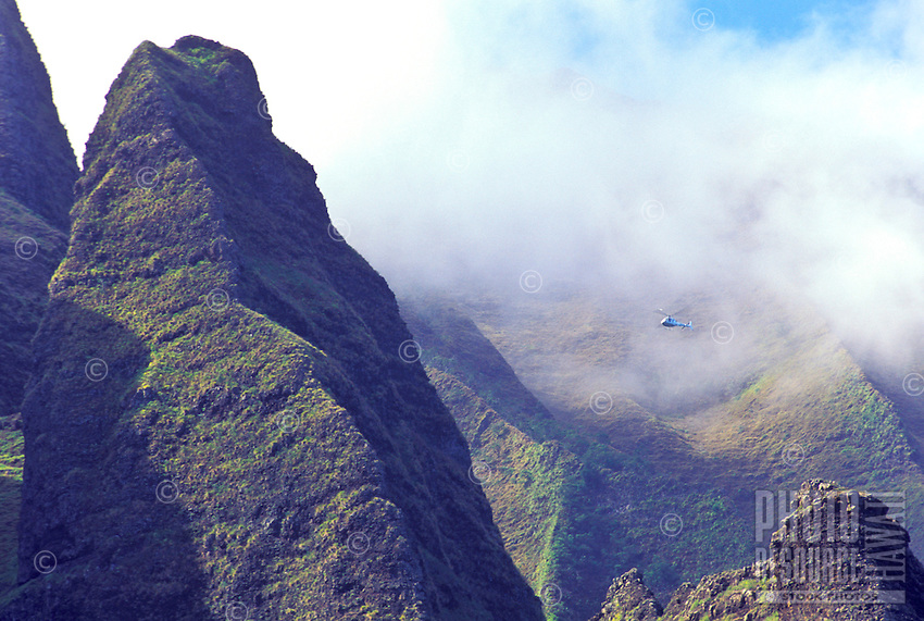 Helicopter tour through the mountainous peaks of the Na Pali coastline, north shore of Kauai