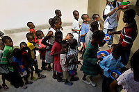 Haitian kids wait in a line to be given food for free in Saint Claire, the education and feeding center run by Fr. Gérard Jean-Juste in Port-au-Prince, Haiti, July 8, 2008.