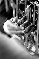 Black & white close up of hands playing a tuba. New Orleans Louisiana United States French Quarter.