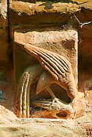 Norman Romanesque exterior corbel no 1 - sculpture of a quail that it has just killed its young. This is based on a  bestiary story that tells of a Pelican that kills its young. It then pecks its breast to draw blood and sits on its dead offspring and the blood brings the young bird back to life. This is an allegory of Christ giving his blood on the cross for mankind. The Norman Romanesque Church of St Mary and St David, Kilpeck Herefordshire, England. Built around 1140