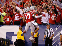Ohio State Buckeyes wide receiver Devin Smith (9) celebrates with Ohio State Buckeyes running back Jalin Marshall (17) after a touchdown in the third quarter of the Big Ten Championship game at Lucas Oil Stadium in Indianapolis on Saturday, December 6, 2014. (Columbus Dispatch photo by Jonathan Quilter)