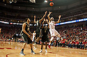 February 23, 2014: Terran Petteway (5) of the Nebraska Cornhuskers shoots a jumper over Sterling Carter (1) of the Purdue Boilermakers and Terone Johnson (0) of the Purdue Boilermakers during the second half at the Pinnacle Bank Arena, Lincoln, NE. Nebraska 76 Purdue 57.