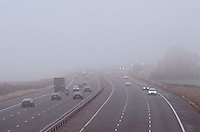 Vehicles driving in heavy fog on the motorway. This image may only be used to portray the subject in a positive manner..©shoutpictures.com..john@shoutpictures.com