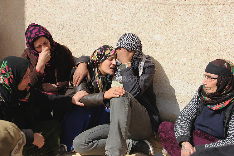 1/3/2015--Kobane,Syria-- A family of kobane who lost their son, father of five children in the fighting against ISIS.