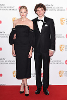 Gabriella Wilde and Josh Whitehouse in the winners room for the BAFTA TV Awards 2018 at the Royal Festival Hall, London, UK. <br /> 13 May  2018<br /> Picture: Steve Vas/Featureflash/SilverHub 0208 004 5359 sales@silverhubmedia.com