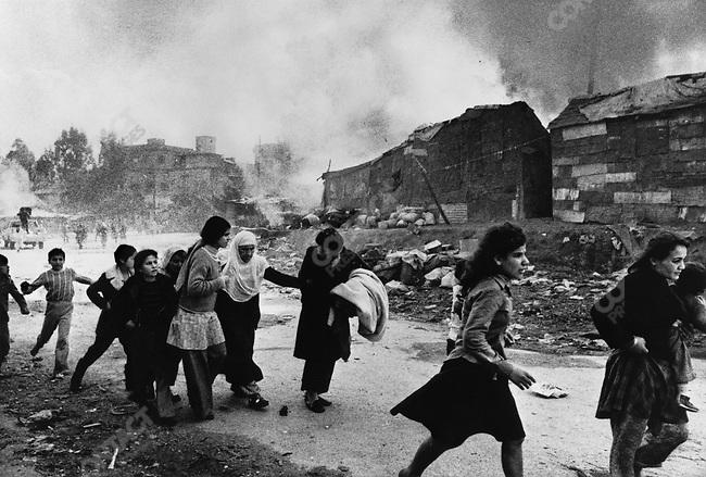 Paletinians fleeing massacre by Christian gunmen, Karantina, Beirut, Lebanon, January 18, 1976