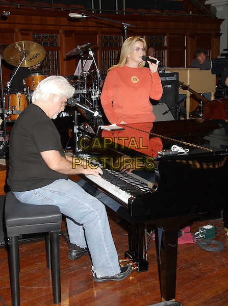TRISHA YEARWOOD & MICHAEL MCDONALD.Songs of the Year Taping Presented by Cracker Barrel held at Schermerhorn Symphony Center, Nashville, Tennessee, USA, 05 November 2006..half length red top glasses singing music rehearsing rehearsal piano.Ref: ADM/LF.www.capitalpictures.com.sales@capitalpictures.com.©Laura Farr/AdMedia/Capital Pictures.