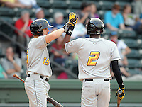 Outfielder Josh Bell (2) of the West Virginia Power is congratulated after scoring a run by Eric Wood (15) in a game against the Greenville Drive on Tuesday, April 16, 2013, at Fluor Field at the West End in Greenville, South Carolina. Bell is the No. 6 prospect for the Pittsburgh Pirates, according to Baseball America. West Virginia won, 8-3. (Tom Priddy/Four Seam Images)  .