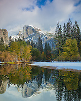 Yosemite National Park, CA<br /> Half Dome (8842 ft) reflected in the Merced River after a clearing snowstorm in fall in Yosemite Valley