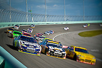 Jimmie Johnson (#48) goes 3-wide overtaking cars on his way back to the front after a pit stop.