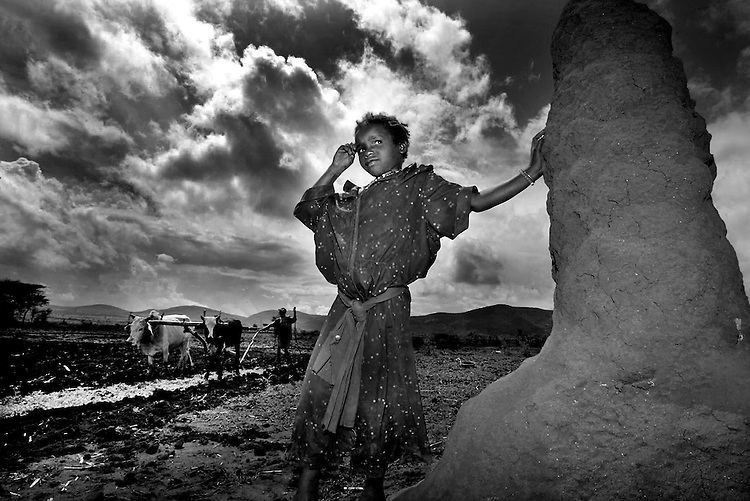 Waiting for Rain.....Tano Kote, age 7 from the village of Harallo 80km from the Kenyan southern Ethiopian border pictured here waiting for rain while her father ploughs their maize field during the continuing drought in the region. Pic Robbie Reynolds/GOAL.