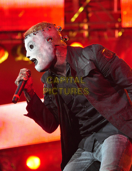 COREY TAYLOR of SLIPKNOT.Performs on day three of the Roskilde Festival in Roskilde, Denmark, .July 4th 2009..music live on stage gig concert half length singing mask profile microphone .CAP/TTL .©TTL/Capital Pictures