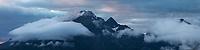 Himmeltindan mountain peaks emerge from clouds, Vestvågøy, Lofoten Islands, Norway