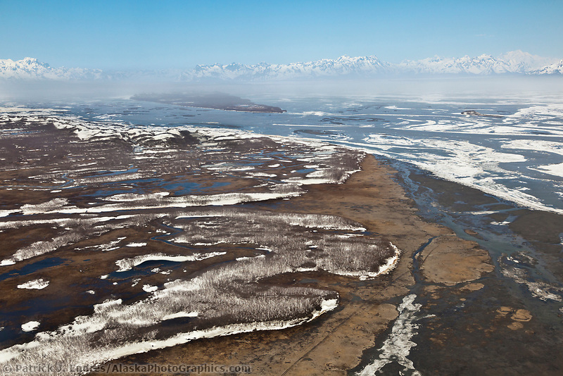 Aerial of the dusty, windy, Copper River Delta and Chugach mountains, Alaska.
