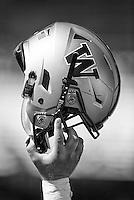 The Washington helmet, held aloft.  This is a digital illustration.