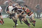 Steven Bates attempts to tackle Male Sa'u during the Air NZ Cup week 5 game between Waikato & Counties Manukau played at Rugby Park, Hamilton on 26th of August 2006.