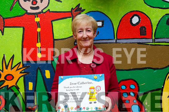 Catherine Dolan, presented with a plaque from the teachers and students to mark the occasion of her retirement from the CBS primary school.