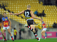 Nick Riewoldt punts during the Australian Rules Football ANZAC Day match between St Kilda Saints and Brisbane Lions at Westpac Stadium, Wellington, New Zealand on Friday, 25 April 2014. Photo: Dave Lintott / lintottphoto.co.nz
