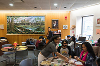 Cynthia Tim, 20, (front from left), Neil Sunil, 21, Karonika Brown, 24, and others gather in the Asian American Connections Center, on Thurs., Feb. 15, 2018, before a Lunar New Year celebration.  The Asian American Connections Center was established at the school using a federal grant in 2016 and serves as a focal point for the Asian community at the school, predominantly Cambodian, to gather, socialize, study, and otherwise take part in student life.